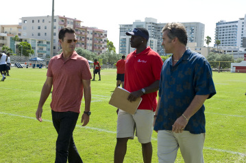 "BURN NOTICE -- ""Hot Spot"" Episode 211 -- Pictured: (l-r) Jeffrey Donovan as Michael Westen, Michael Irving as Sean Coach Martin, Bruce Campbell as Sam Axe -- USA Network Photo: Glenn Watson"