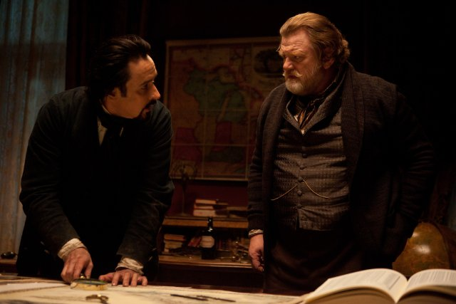 "John Cusack plays Edgar Allen Poe and Brendan Gleeson plays Captain Hamilton  in the Relativity Media film ""The Raven."""